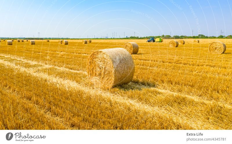 Aerial view of straw bales on farm fields Above Agricultural Agriculture Arable Bale Baler Baling Cereal Compact Country Crop Cultivated Cultivation Dolly Dry