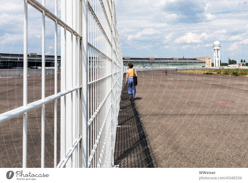 You can walk across the former airfield for a long time, but the fence prevents unauthorized entry into the last security areas Airport Tempelhof Berlin