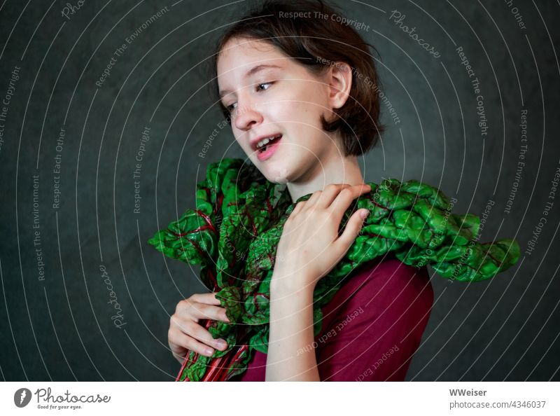 Such a chard is not only healthy and delicious, but also extraordinarily dressy Mangold Girl portrait Vegetable leaves vegetarian Fresh Delicious Smiling