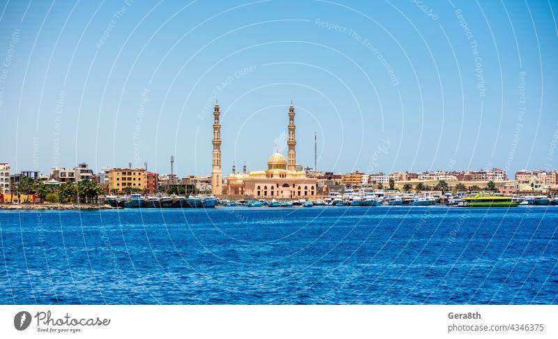 many ships in the Hkrgada Marina in the Red Sea Africa Hurghada bay beach blue blue sky blue water boat boat trip boats boats tied coast coastline cruise egypt