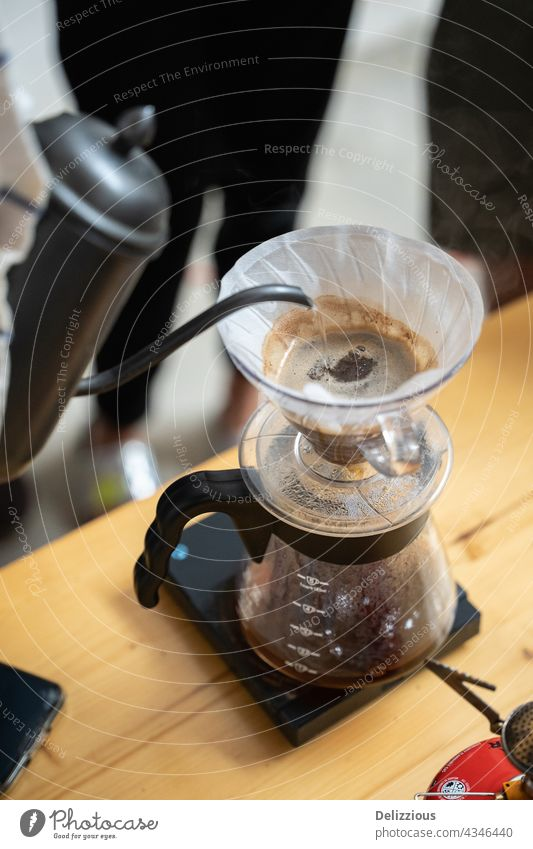 Making process of V60 coffee, filter coffee, pouring hot water on the coffee v60 background brew paper making brewing barista hot drink hipster drip beverage
