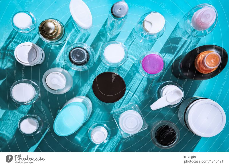 Plastic bottles with shade Things Detail Blue Bottle Bottle lid Cosmetics cosmetic products Packaging Harmful Environmental pollution Environmental damage