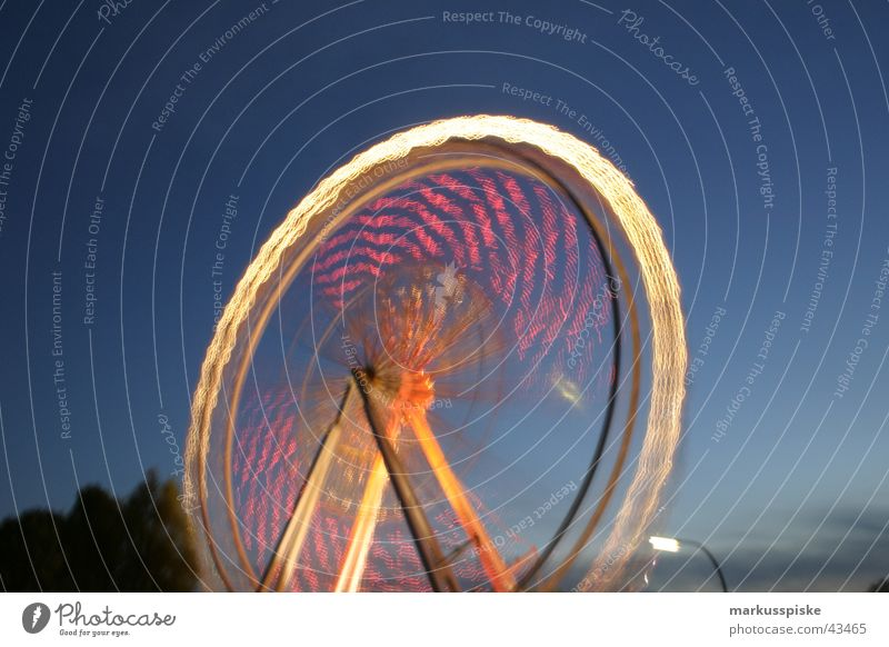the big wheel Ferris wheel Fairs & Carnivals Night Light Long exposure Multicoloured Twilight Speed Rotate Leisure and hobbies fair Sky Blue Colour