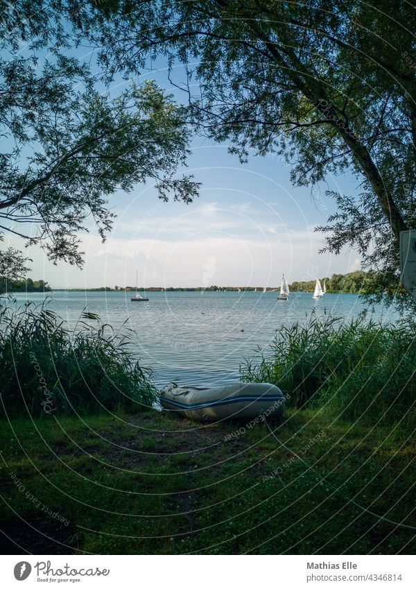 Rubber dinghy on a lake Dinghy Lake boat boats rubber boat Air Meadow go boating boat tour Boating trip Lakeside Waves Gravel pit Erfurt local recreation area