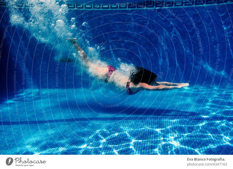 caucasian woman diving in swimming pool. underwater view. Summer time and vacation concept fun summer love blue water sunny day outdoors relax happy beautiful