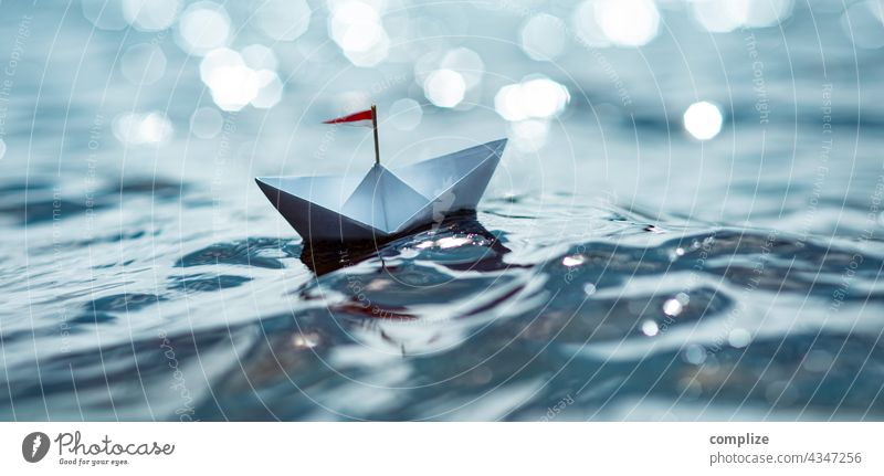 Small paper ship in the sunshine on the sea Freedom Sunbeam Sunlight coast Sailboat Target Paper boat Navigation Infancy Beach Summer vacation Water Nature