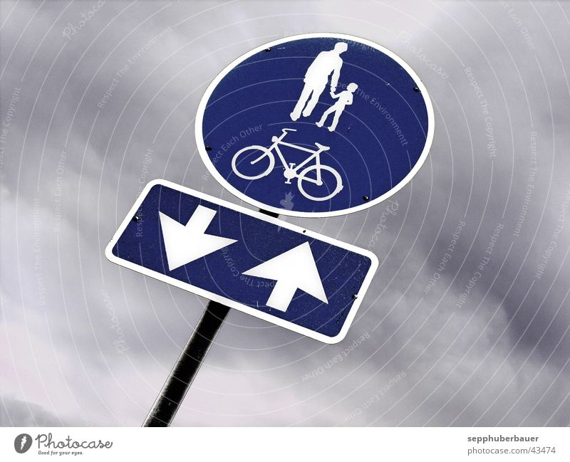 Blue Clouds Lanes & trails Gray Bicycle Signs and labeling Transport Arrow Graphic Storm clouds Road sign Cycle path