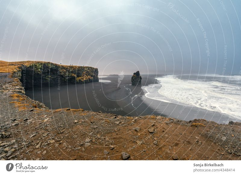 Reynisfjara - black beach in the south of Iceland Beach Black Sand Icelandic South Iceland cliffs rock Ocean Waves Nature Landscape Sky Clouds Dramatic Weather