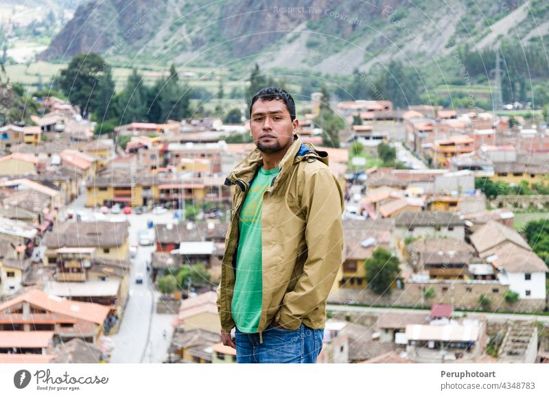 Tourist observing the city with a panoramic view in Ollantaytambo is a town in the Sacred Valley of Peru, which lies south on the Urubamba River and is surrounded by snow-capped mountains.