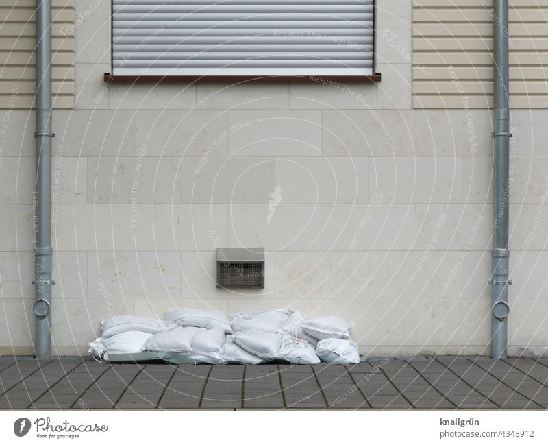 flood protection Sandbags House (Residential Structure) Deluge Downpipe Downspout New building about each other Wall (building) Wall (barrier) Colour photo