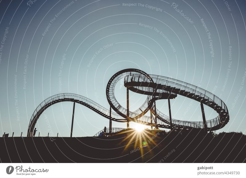The eternal up and down (only for those free from giddiness) Roller coaster Leisure and hobbies Multicoloured Exterior shot Sky Blue Copy Space top Joy Sun