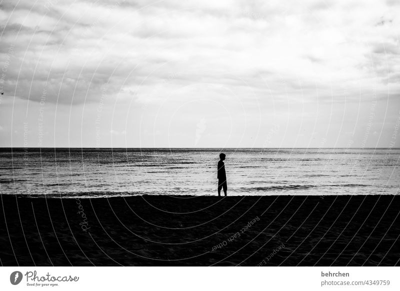 The young man and the sea Dramatic Usedom Black & white photo Freedom Nature Waves Water Idyll Longing Wanderlust wide Clouds Sky Baltic Sea Ocean Beach