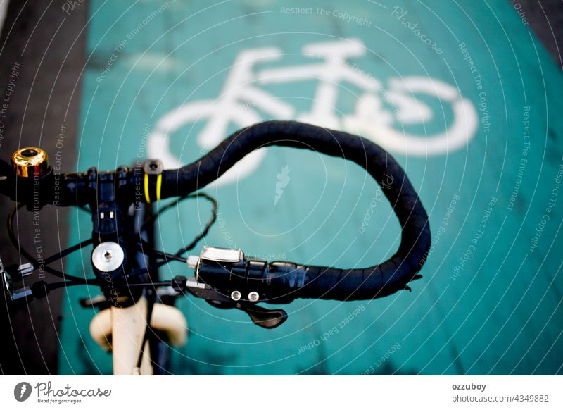 close up handlebar and bicycle lane sign on the street bike summer sport background travel ride transport lifestyle outdoor vintage design old closeup