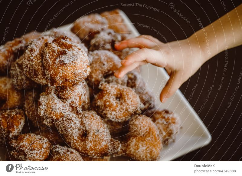 A hand reaches for pancakes | Quarkbällchen | Prilleken | Krapfen | Carnival pastries Pancake Quarkballs Donut Mardi Gras Cookies cute Delicious Food Dessert