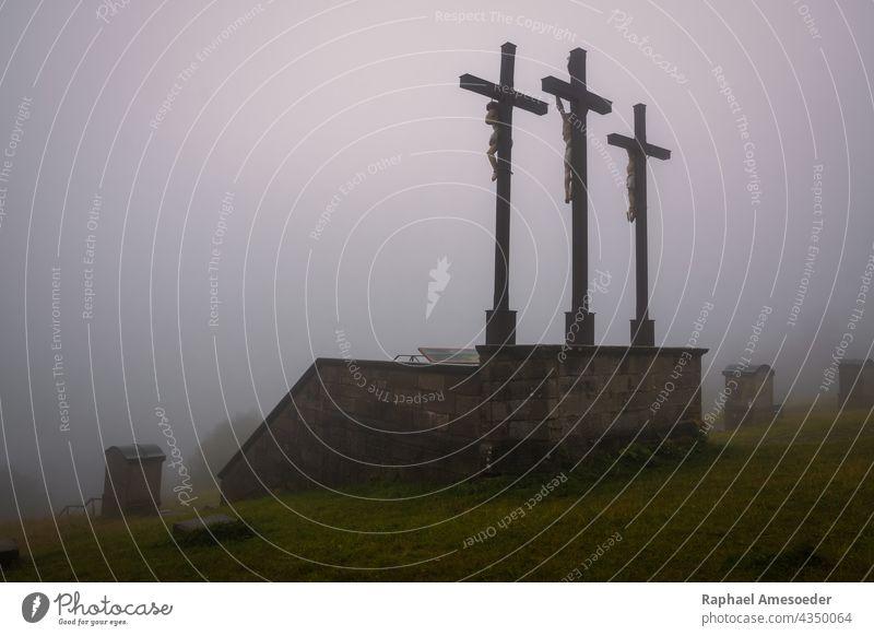Three crosses on Kreuzberg mountain in Rhoen, rainy summer day architecture atmosphere blue catholic christian christianity church clouds crucifix dark death