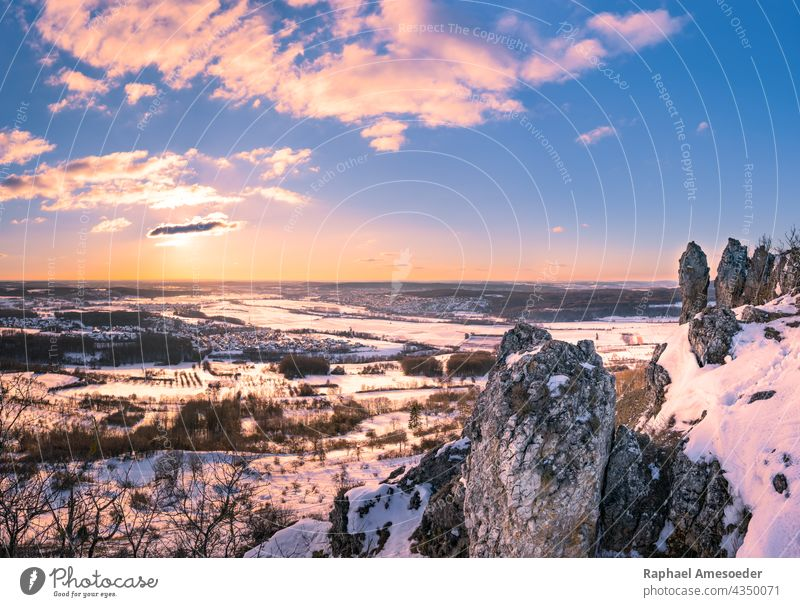 Panoramic view of winter landscape from mountain Walberla in Franconian Switzerland beautiful branch bush cliff cloud countryside culm day europe european