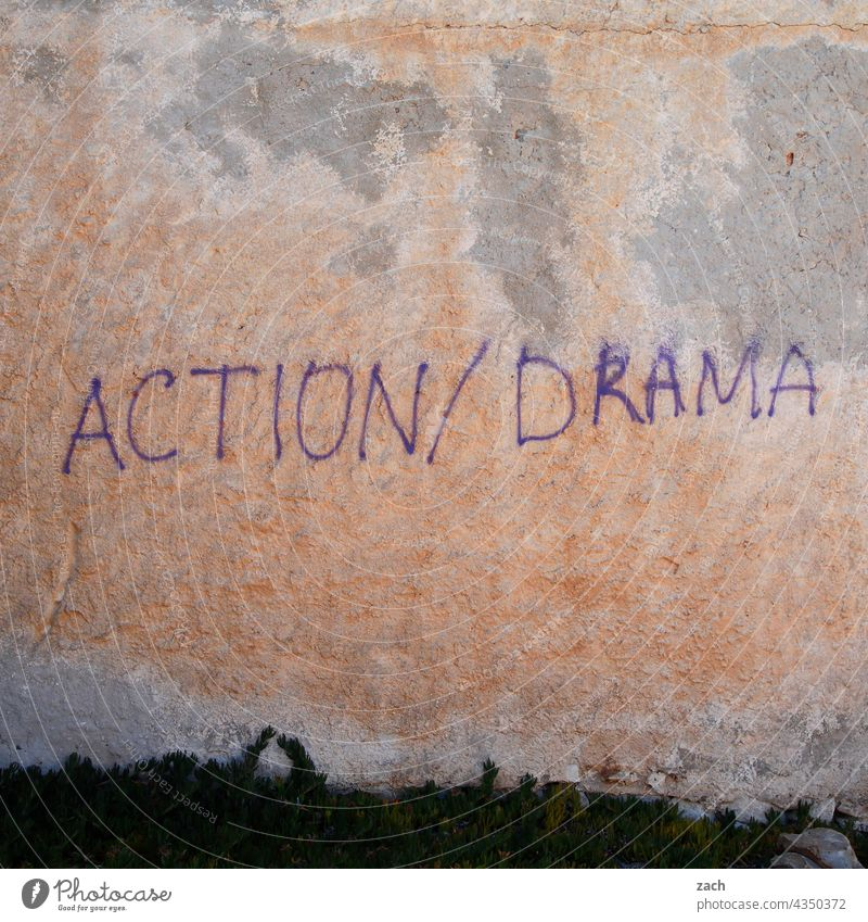Action/Drama action Dramatic drama Wall (building) Facade Graffiti Characters Daub Letters (alphabet) Wall (barrier) Word
