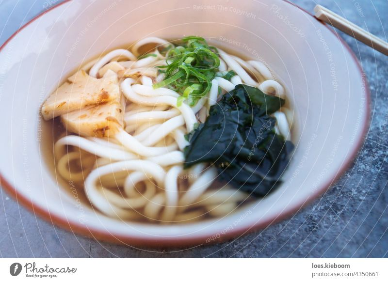 Bowl with japanese Ramen with Udon noodles and bamboo food soup bowl lunch meal udon asia cuisine delicious gourmet green ramen white hot asian chopsticks dish