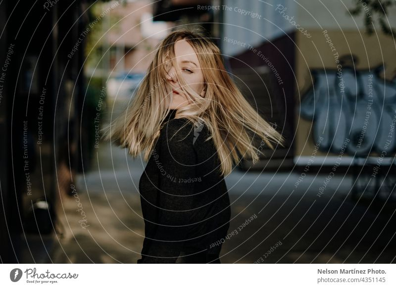 Portrait of a beautiful blonde caucasian woman moving her hair portrait urban style confident lifestyle attractive young Style girl Caucasian Fashion people
