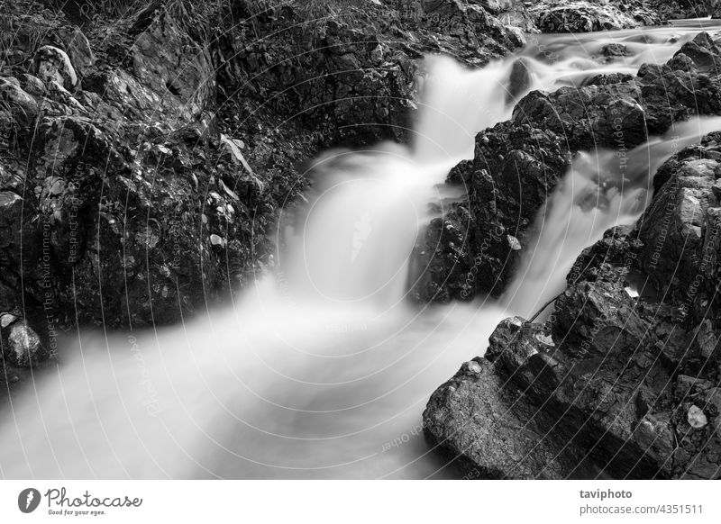 black and white image of beautiful waterfall stunning breathtaking abstract cliff nature river cascade natural outdoor background environment flow beauty rock