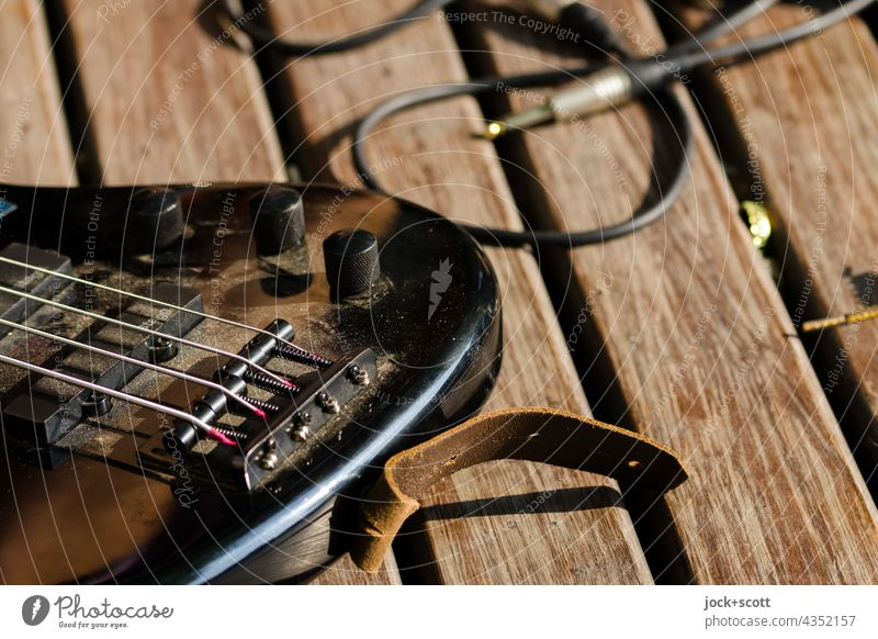 Street music with electric guitar + audio cable in detail Musical instrument Musical instrument string String instrument Detail Leisure and hobbies Rotary knob