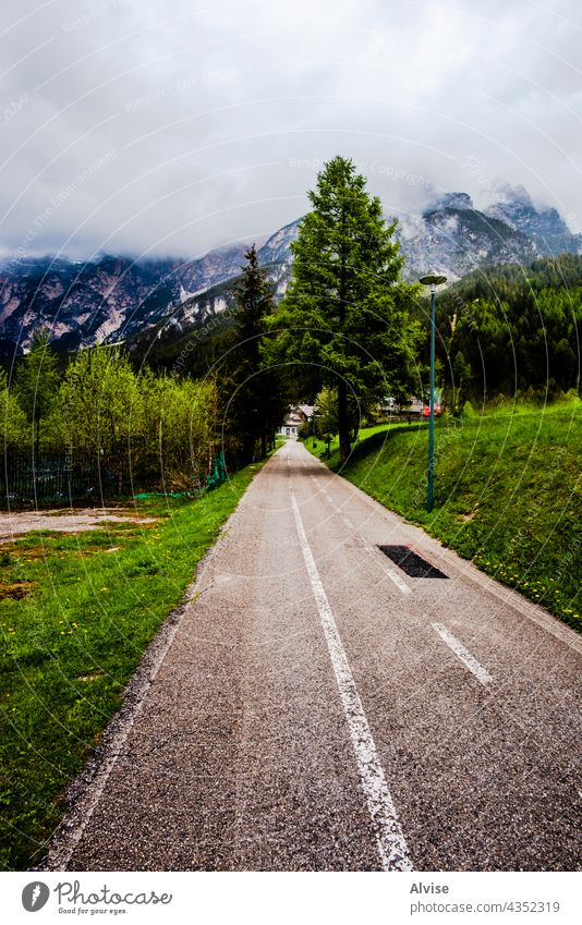 2021 05 15 Cortina bicycle lane summer travel path italy mountain alps nature outdoor cycling peak dolomite scenery landscape beautiful forest alpine trail