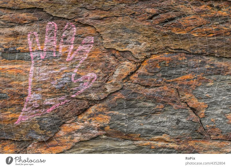 Drawn hand on an oxidized natural stone. masonry Stone urban interstices Graffiti Manmade structures Stone wall Wall (building) street art Subculture Culture