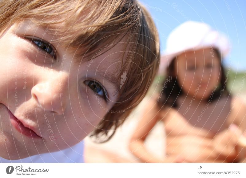 child looking straight into the camera real people Parenting supervision Parents sight eyes secret Contentment Mysterious youthful Uniqueness Change Identity