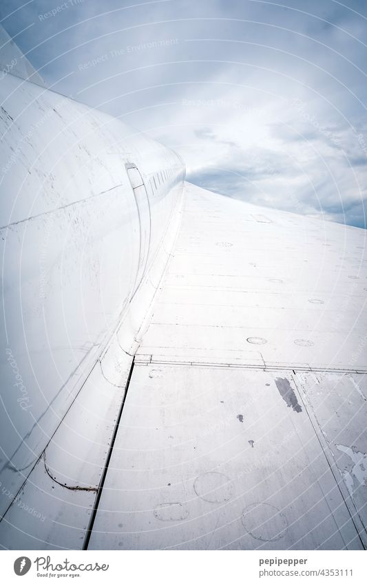 Plane in the clouds Airplane Grand piano Aircraft wing Sky Clouds Aviation Blue Flying Vacation & Travel Passenger plane Tourism Exterior shot Freedom Wing