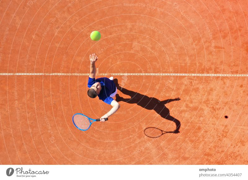 Aerial View of a Tennis Player Serving with Jump Rebound tennis player ball serve rebound court hitting aerial shoot powerful ace win game set competition jump