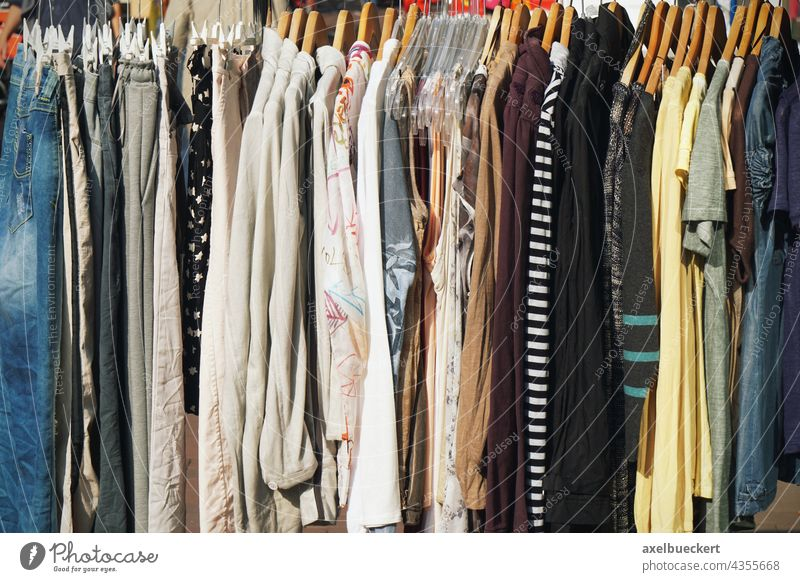 Clothes rail with ladies fashion Clothing Fashion Hallstand clothes rail Hanger Deserted Day SHOPPING Shopping earth tones Style garments clothing market