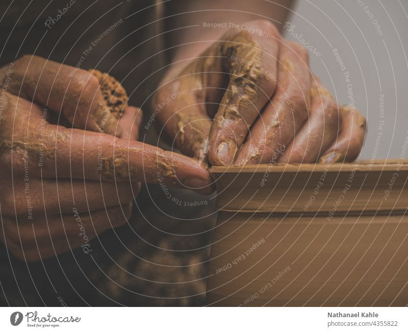 Closeup of hands making pottery on the wheel Do pottery Craft (trade) creatively Tone Pottery hobby Craftsman Workshop work Artisan Threshing disc closeup