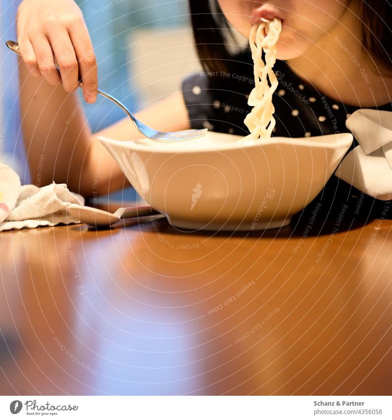 Kid shuffles noodles Eating Noodles Noodle soup Child Nutrition Food Colour photo Lunch Family family life Dinner Table