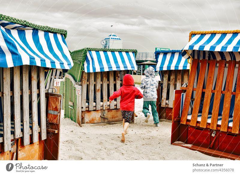 Children running between beach chairs Beach Sand vacation lido Infancy children Bathing beach Summer Ocean Vacation & Travel Sun Swimming & Bathing Relaxation