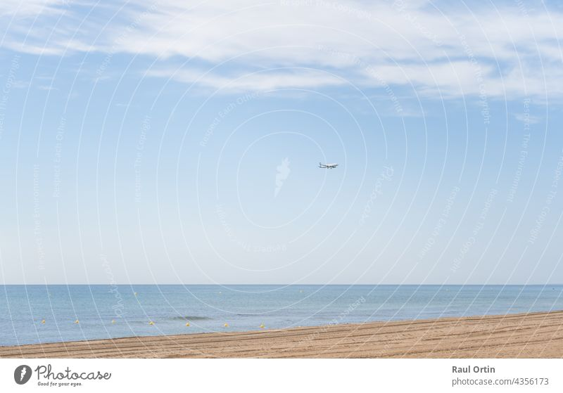Airplane landing above beautiful beach and sea background airplane transport holidays transportation travel coast ocean sky jet airline vacation aircraft flight