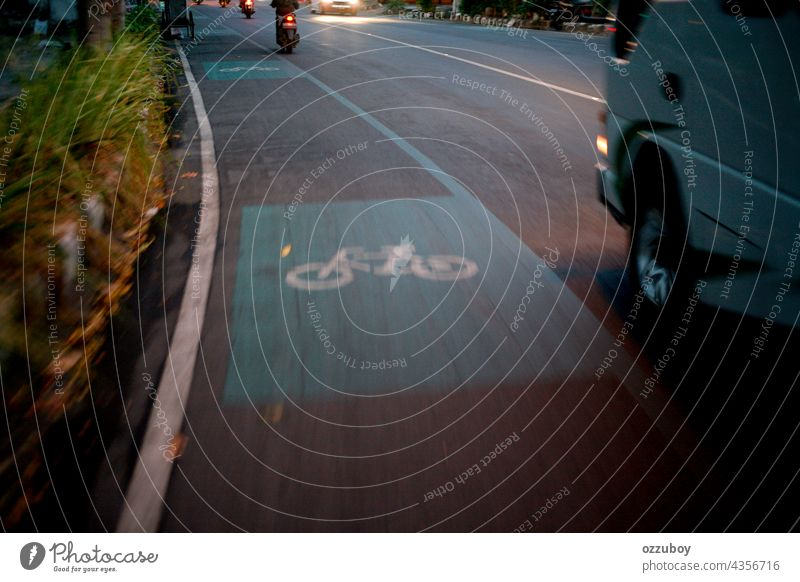 Bicycle road sign on asphalt bicycle lane paint transportation bike symbol city travel path safety traffic route urban white street direction ride way wheel