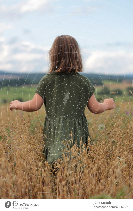 little girl running through an oat field with open arms Oats grains Ear of corn Girl midsummer Mature Dress Spotted short hair Rhön Nature by oneself Walking