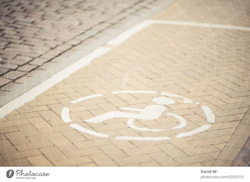 Wheelchair user symbol in a parking area for physically impaired persons physical limitation Parking lot wheelchair users Disability friendly Sign Solidarity