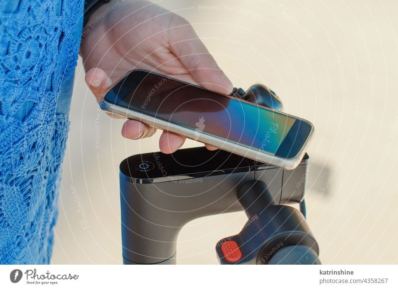 Young man using smartphone to unlock a shared electric scooter app rent copy space Caucasian Student close up Guy Ecology Phone Communication Urban Modern