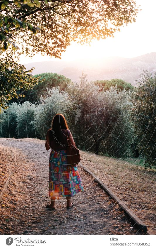 Back view of woman with colorful skirt in nature with evening back light Woman Nature Back-light Evening sun evening light Sunlight Skirt variegated