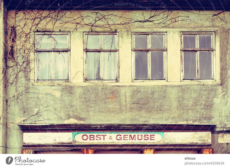 """House facade with four windows and a sign """" Fruit and vegetables """" / Crosseffekt / Lost Place / Property / house facade Facade Window Junk shop"""