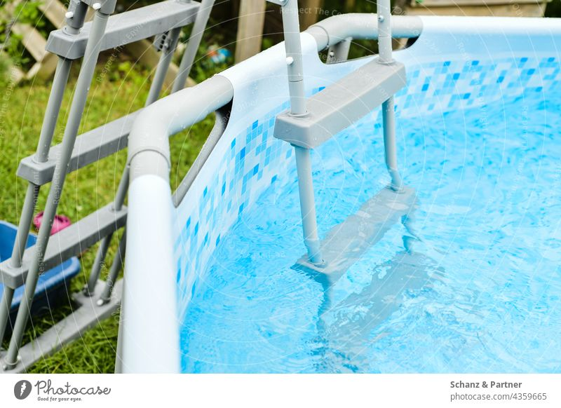Pool ladder swimming pool be afloat Garden Summer ardor Ladder Water Blue Swimming & Bathing Refreshment Vacation & Travel Exterior shot Colour photo