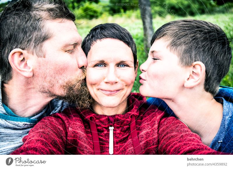 busy | cheeks, heart and love Laughter Smooth Facial hair Close-up Contrast Light Day Warm-heartedness Couple contented Kissing Caresses Emotions tender contact