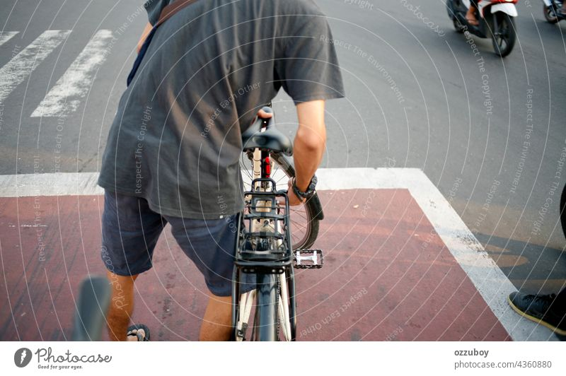 cyclist on the traffic light person bike outdoor street sport bicycle cycling activity road ride healthy lifestyle side biking bicyclist exercise exercising