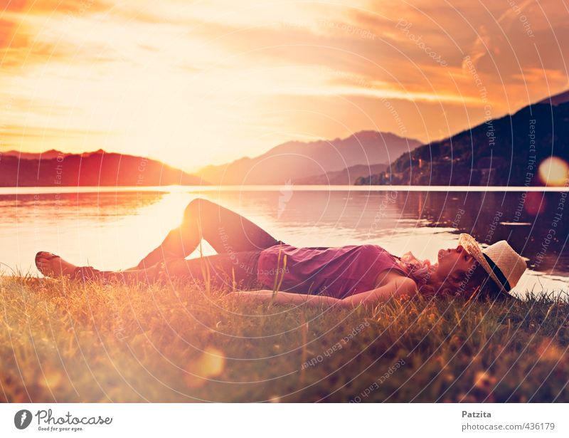 just sleep Woman Girl Lie Sunset Sleep Dream Meadow Lake Water Lakeside Beach Light Reflection Lighting effect Evening Calm Motionless Relaxation Peace Nature