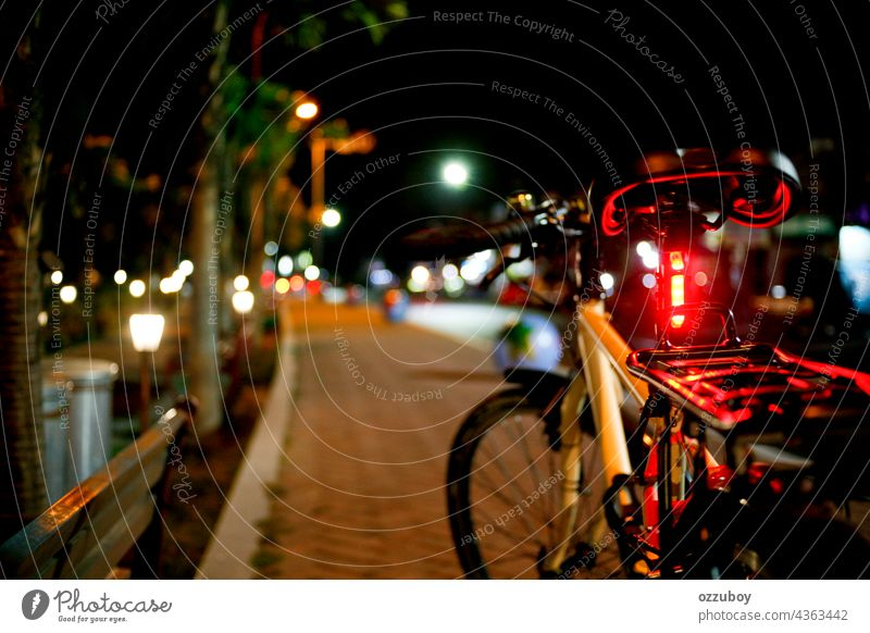 bicycle in the side road at night street city transportation outdoor travel bike light urban lifestyle illuminated dark horizontal ride city life cycling
