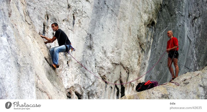 Man Mountaineering Stone Rope Rock Dangerous Stand Threat Climbing To fall Sudden fall Rescue Sports Checkmark Human being Extreme sports