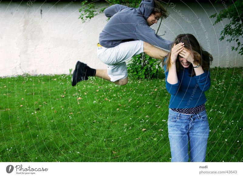 Woman Man Green Blue Black Jump Wall (barrier) Footwear Fear Lawn Anger Sweater Swing Kick