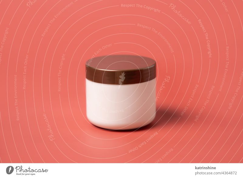 Cosmetic cream jar mockup on pink background can lid red blank copy space closeup container cosmetic bottle empty template package cover beauty skincare