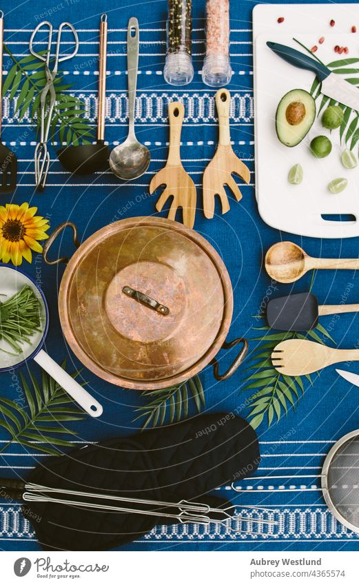 flat-lay of camping cooking supplies on a picnic table blue cookware culinary flat lay food kitchen meal outdoor outdoors outside prepping table cloth tools